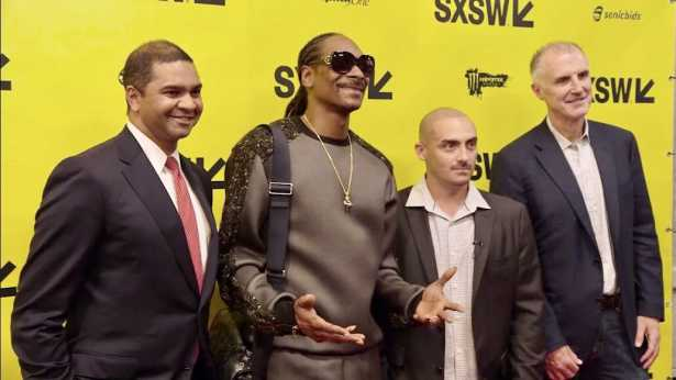 Angelos, third from left, with Snoop Dogg, second from left, along with two Koch Industries executives.
